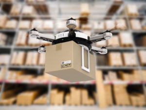 delivery drone in warehouse © PhonlamaiPhoto/GettyImages