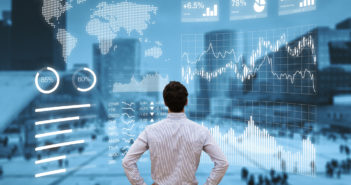 Person analyzing financial dashboard with KPI and business district background © NicoElNino/GettyImages