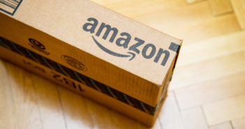 Amazon logotype printed on cardboard box © AdrianHancu/GettyImages