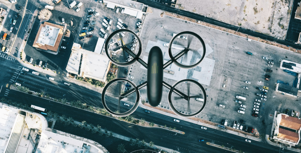 Drone on the lookout. It flys above the streets of a city looking down on buildings and streets.