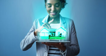 Business Woman holding a digital house_ Digital Transformation in Real Estate